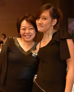 Mrs Liza Ow and student