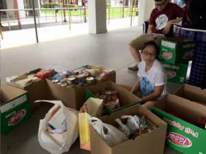 Sorting the collected canned and dry goods