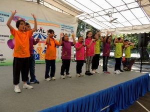 APSN Chaoyang School students performing to the crowd